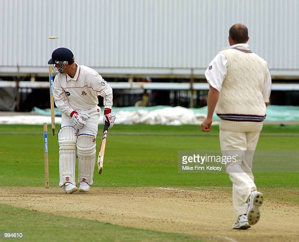 Warren Hegg of Lancashire is clean bowled by Michael Burns of Somerset on the first day of the CricInfo County Championship Division One match at old...