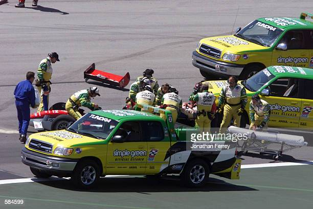 Mauricio Gugelmin is carefully extracated from his car by the Simple Green Safety Crew after his accident during practice for the Target Grand Prix...