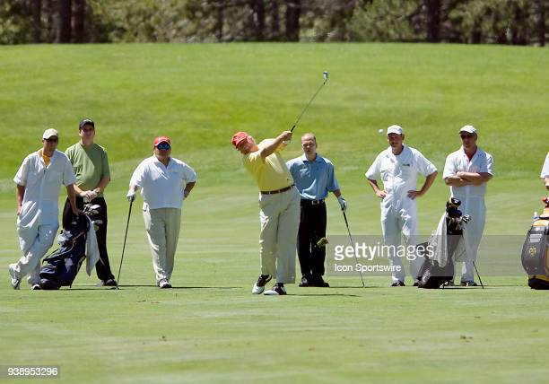 Businessman Donald Trump hits a ball from the fairway during the 2006 American Century Celebrity Golf Tournament played at the Edgewood Tahoe golf...