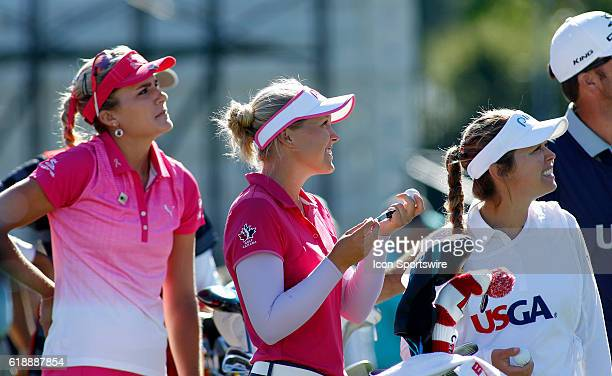 Lexi Thompson Brooke Henderson and Brittany Henderson watch as a plane pulling a 'Dump Trump' banner flies overhead at the LPGAUS Women's Open at...