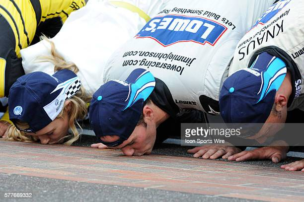 Jimmie Johnson Hendrick Motorsports Chevrolet Impala SS kisses the bricks after winning the Allstate 400 at the Brickyard NASCAR Sprint Cup Series...