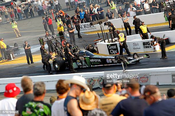 The crew for Brittany Force checks her car prior to the qualifying session at the NHRA Sonoma Nationals in Sonoma CA