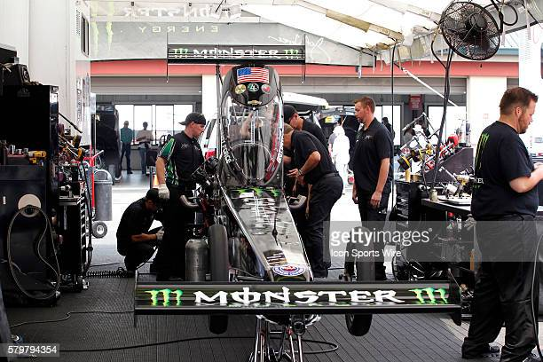 The crew for Brittany Force prep her car prior to the qualifying session at the NHRA Sonoma Nationals in Sonoma CA
