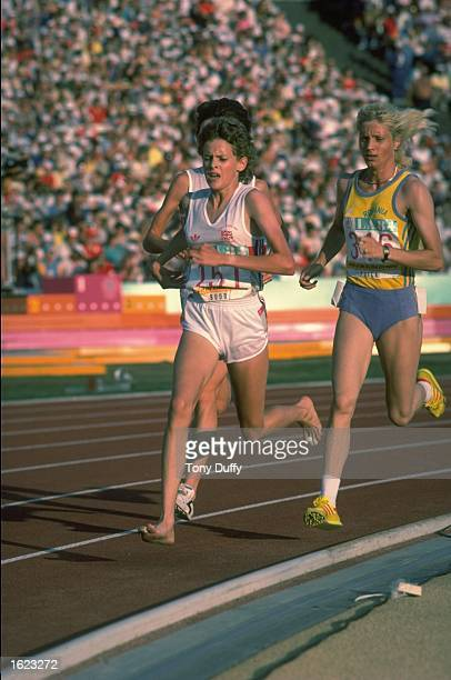 Zola Budd of Great Britain leads Maricica Puica of Romania during the 3000 Metres final at the 1984 Olympic Games in Los Angeles USA Puica won the...