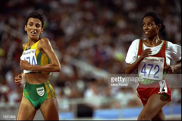 Elena Meyer of South Africa leads from Derartu Tulu of Ethiopia during the Womens 10000 metres event of the 1992 Olympic Games at the Monjuic Stadium...