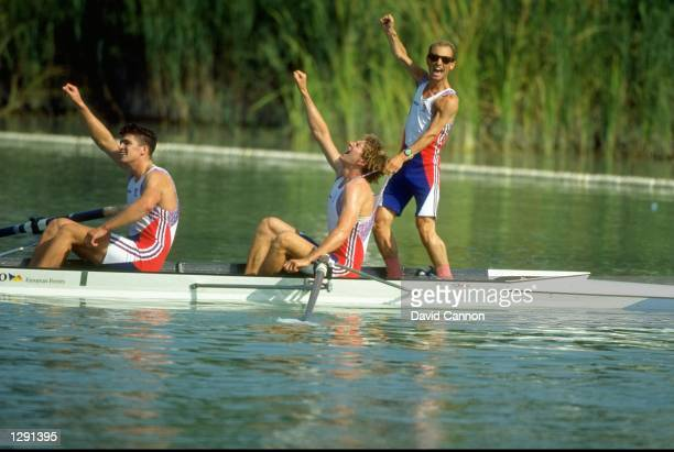 Greg Searle and Johnny Searle celebrate with Gary Herbert the cox all of Great Britain after winning the Coxed Pairs Rowing event at the 1992 Olympic...