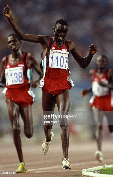 Matthew Birir of Kenya celebrates as he crosses the line ahead of Patrick Sang and William Mutwol also of Kenya to win the gold medal in the Mens...