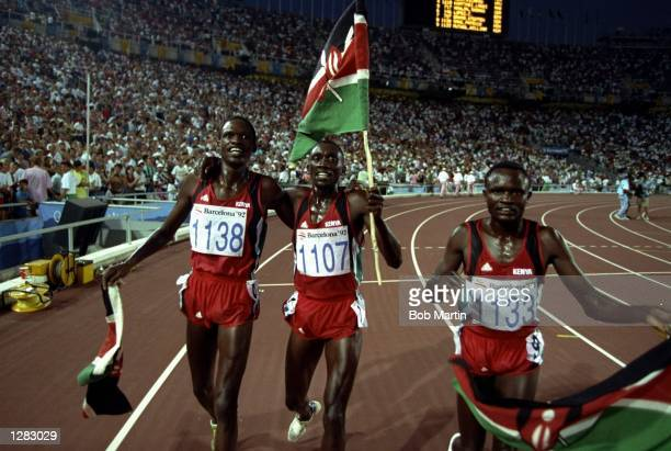 Matthew Birir of Kenya celebrates with Patrick Sang and William Mutwol also of Kenya after the Mens 3000 metres Steeplechase event during the1992...