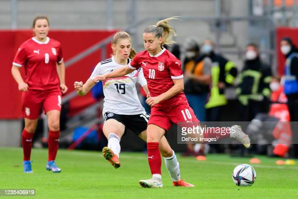 Jule Brand of Germany and Jelena Cankovic of Serbia battle for the ball during the FIFA Women's World Cup 2023 Qualifier group H match between...