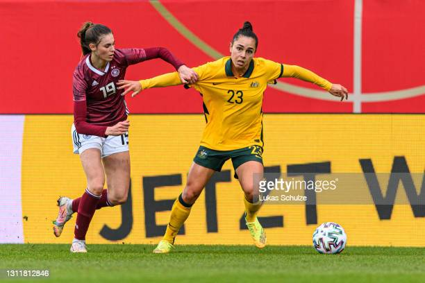 Jule Brand of Germany challenges for the ball with Emma Checker of Australia during the International Friendly between Germany and Australia at...