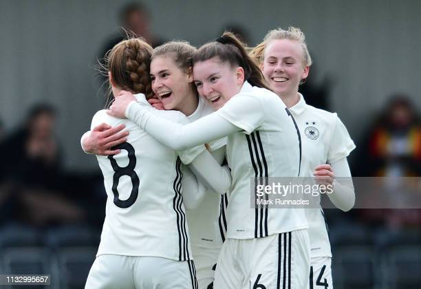 Jule Brand of Germany is congratulated by her team mates after scoring the fourth goal of the game for Germany during the UEFA Elite Round match...