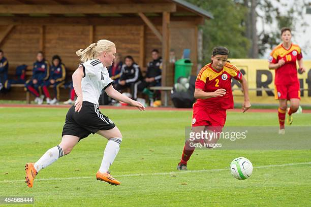 Jule Dallmann of Germany challenges Alina Boros of Romania during the international friendly match between U17 Girl's Germany and U17 Girl's Romania...