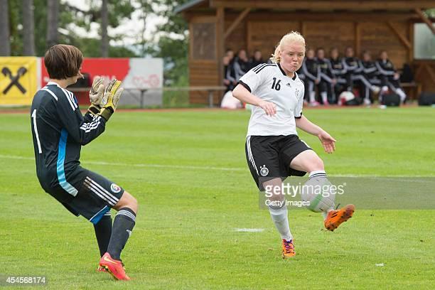 Jule Dallmann of Germany challenges Georgiana Maria Darle of Romania during the international friendly match between U17 Girl's Germany and U17...