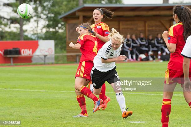 Jule Dallmann of Germany challenges Valentina Petre Indrei of Romania during the international friendly match between U17 Girl's Germany and U17...