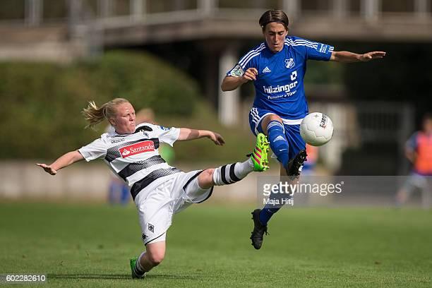 Jule Dallmann of VfL Borussia Moenchengladbach is challenged by Anne van Bonn of SC Sand during the match of Allianz Frauen Bundesliga on September...