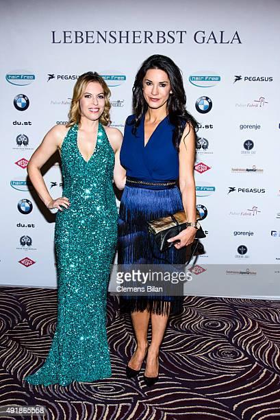 Jule Goelsdorf and Mariella Ahrens attend the Lebensherbst charity gala at Waldorf Astoria on October 8 2015 in Berlin Germany