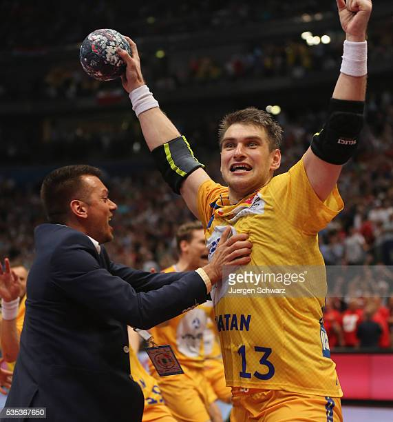 Julen Ahuinagalde Akizu of Kielce celebrates after scoring the final penalty during the EHF Champions League Final against MKB Veszprem on May 29...