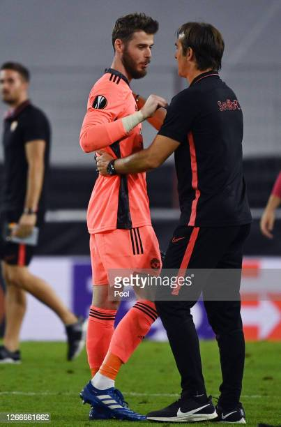 Julen Lopetegui, Head Coach of Sevilla FC and David De Gea of Manchester United interact following the UEFA Europa League Semi Final between Sevilla...