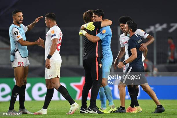 Julen Lopetegui, Head Coach of Sevilla FC and Yassine Bounou celebrate following their sides victory in the UEFA Europa League Semi Final between...