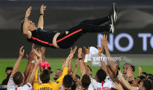 Julen Lopetegui, Head Coach of Sevilla is thrown into the air in celebration by his players following their team's victory in the UEFA Europa League...