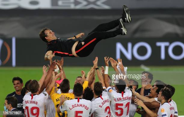 Julen Lopetegui Head Coach of Sevilla is thrown into the air in celebration by his players following their team's victory in the UEFA Europa League...