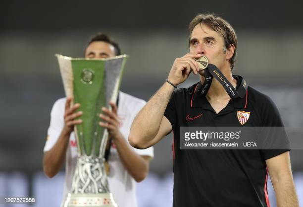 Julen Lopetegui, Head Coach of Sevilla kisses his winners medal following his team's victory in the UEFA Europa League Final between Seville and FC...