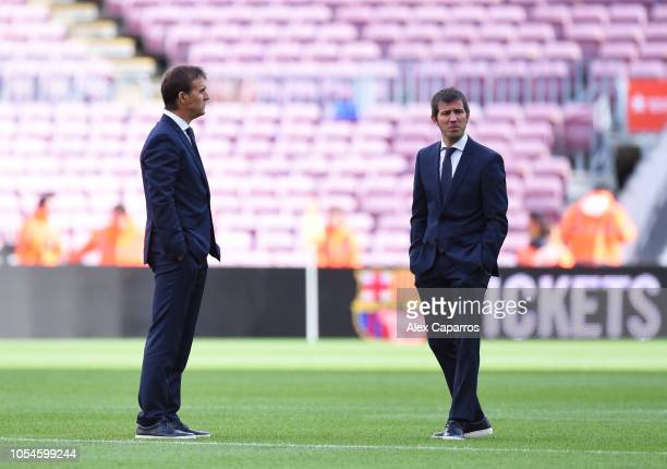 Julen Lopetegui Manager of Real Madrid and assistant Albert Celades walk on the pitch prior to the La Liga match between FC Barcelona and Real Madrid...