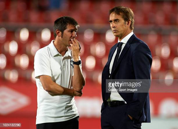 Julen Lopetegui Manager of Real Madrid talks to his assistan Albert Celades during the La Liga match between Girona FC and Real Madrid CF at...