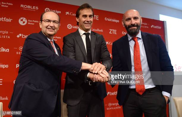 Julen Lopetegui poses with the president of Sevilla FC, Jose Castro and the team's director of football, Monchi, during Lopetegui's presentation as...
