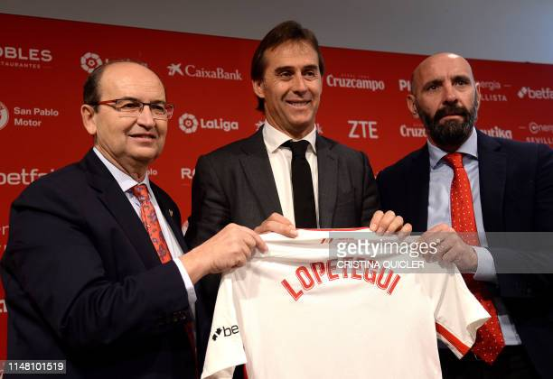 Julen Lopetegui poses with the president of Sevilla FC Jose Castro and the team's director of football Monchi during Lopetegui's presentation as new...