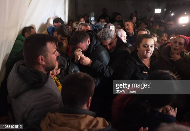 Julen Rosello's parents are seen crying with their relatives and friends during a vigil for the 2 year old boy who fell into a well more than 100...