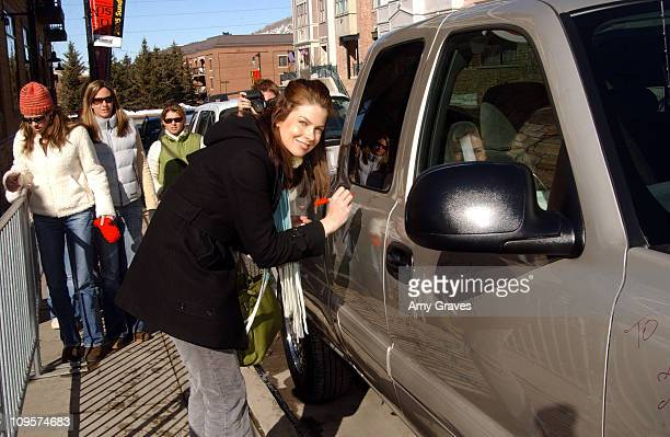 Jules Asner autographs a 2005 Chevrolet Silverado Pickup which General Motors will donate to the National Ability Center a local charity organization