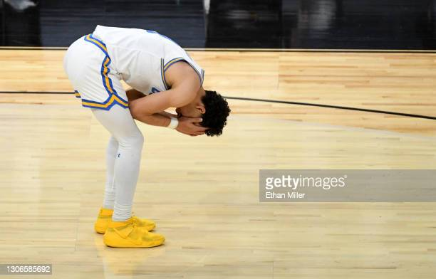 Jules Bernard of the UCLA Bruins reacts after he turned the ball over to the Oregon State Beavers in overtime of their game during the quarterfinals...