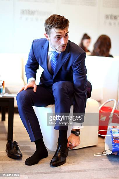Jules Bianchi of France and Marussia prepares to take part in the Amber Lounge Fashion Show ahead of the Monaco Formula One Grand Prix at Circuit de...
