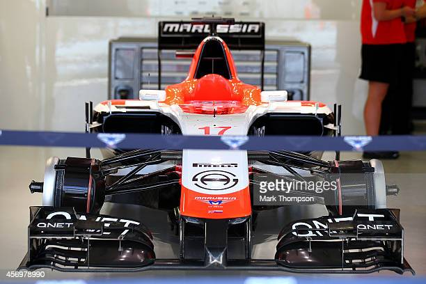 Jules Bianchi of France and Marussia's car remains in the garage during practice ahead of the Russian Formula One Grand Prix at Sochi Autodrom on...