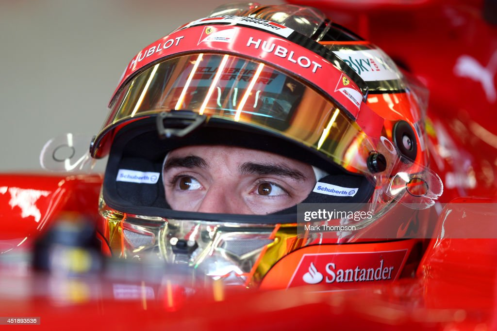 Jules Bianchi of France sits in a Ferrari in the garage during day two of testing at Silverstone Circuit on July 9, 2014 in Northampton, England.