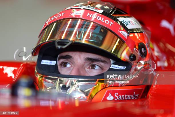 Jules Bianchi of France sits in a Ferrari in the garage during day two of testing at Silverstone Circuit on July 9 2014 in Northampton England