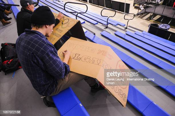 Jules Burnotte of Sherbrooke Quebec makes a sign encouraging Calgary's 2026 Olympic bid during the ISU World Cup Short Track Calgary at the Olympic...