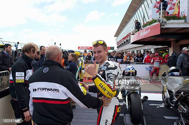 Jules Cluzel of French and Foward Racing celebrates the victory under podium with his crew at the end of Moto2 race of British Grand Prix at...