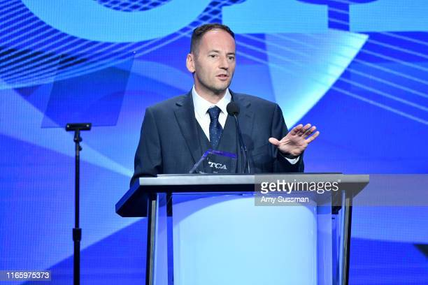 Jules Cornell accepts the Outstanding Achievement in News and Information Award for Leaving Neverland onstage during the TCA Awards at The Beverly...