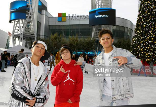 Jules Coutinho Mason Coutinho and guest attend Instagram's #Instaskate 2018 at LA Kings Holiday Ice LA Live on November 27 2018 in Los Angeles...
