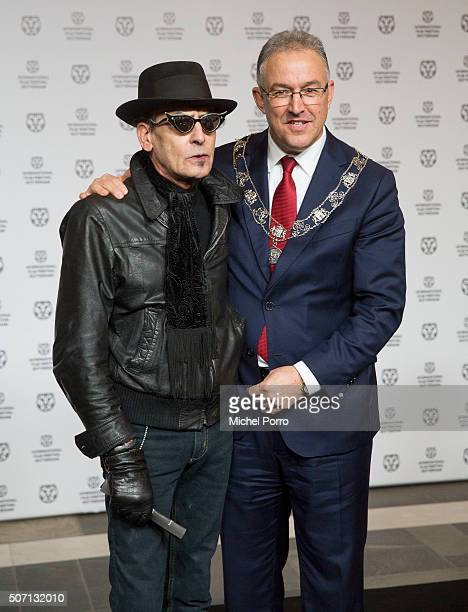 Jules Deelder and Ahmed Aboutaleb attend the opening of the Rotterdam International Film Festival on January 27 2016 in Rotterdam Netherlands