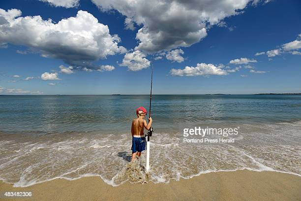 Jules Dochtermann 4 of Berlin Germany the grandson of park ranger Glenn 'Doc' Dochtermann watches his line while surf casting at Ferry Beach State...