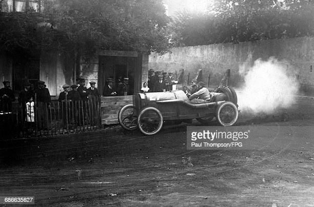 Jules Goux of France and his riding mechanic aboard the Peugeot L76 during the I Coupe de la Sarthe voiturette race on 9 September 1912 at the Sarthe...