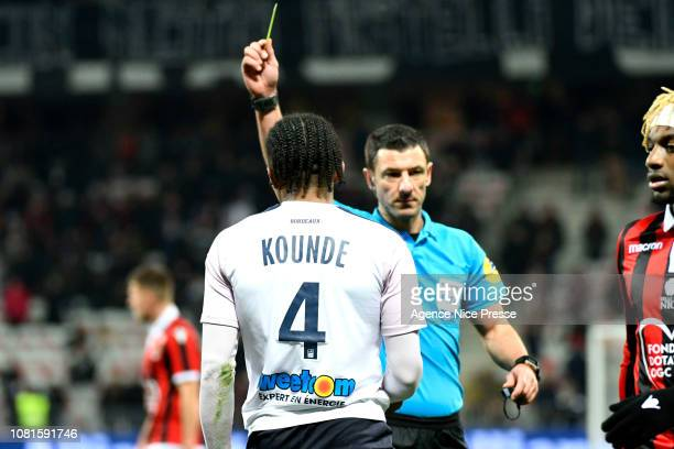Jules Kounde of Bordeaux receives a yellow card during the Ligue 1 match between Nice and Bordeaux at Allianz Riviera on January 12 2019 in Nice...