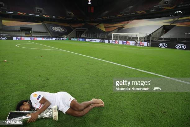 Jules Kounde of Sevilla FC celebrates with the UEFA Europa League Trophy following his team's victory in the UEFA Europa League Final between Seville...