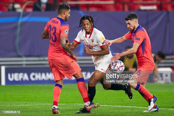 Jules Kounde of Sevilla FC competes for the ball with Jorginho of Chelsea FC during the UEFA Champions League Group E stage match between FC Sevilla...