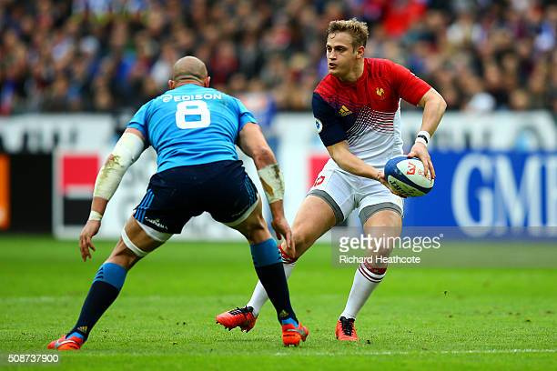 Jules Plisson of France passes the ball under pressure from Sergio Parisse of Italy during the RBS Six Nations match between France and Italy at...