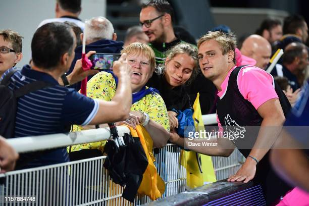 Jules Plisson of Stade Francais Paris poses for a photo with fans following the pre-season friendly match between Nevers and Stade Francais on July...