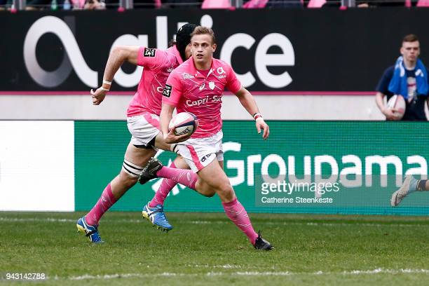 Jules Plisson of Stade Francais Paris runs with the ball during the French Top 14 match between Stade Francais Paris and ASM Clermont Auvergne at...